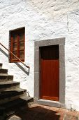 ISLAND PATMOS, GREEK CIRCA JUNE 2005 - Brown door in a stone door frame