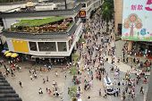 SHENZHEN, CHINA-MAY 27: Shoppers and visitors crowd the famous Dongmen Pedestrian Street on May 27,