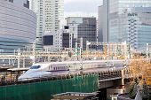 TOKYO- DEC 12, 2013: Shinkansen bullet train depart from Tokyo railway station in Dec 12, 2013 Tokyo, Japan. Shinkansen is world's busiest high-speed railway operated by four Japan Railways companies.