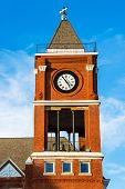 Clock tower of historic small town court house building in Dallas, GA