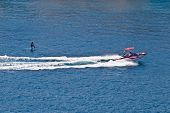 picture of ski boat  - Sit down hydrofoil ski sport speedboat on blue sea - JPG