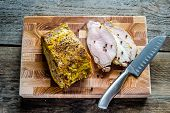 stock photo of marinade  - Roast Pork Tenderloin with mustard marinade on the cutting board - JPG