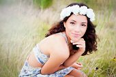 picture of toothless smile  - Teenage girl in a field of flowers - JPG
