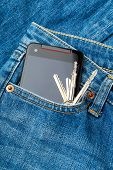 Blue jean pocket with mobile and door key