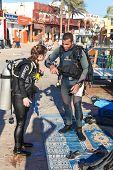 DAHAB, EGYPT - JANUARY 24, 2011: Divers preparing to dive on the coast on January 24, 2011 in Dahab,
