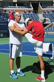 Six times Grand Slam champion  Novak Djokovic stretching before practice for US Open 2013