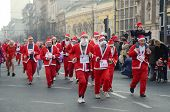 BELGRADE, SERBIA - DECEMBER 29: Unidentified participants of the sixth annual Belgrade Santa's Race on Dec. 29, 2013 in Belgrade, Serbia