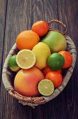 foto of sweetie  - Citrus fruits in wicker basket on wooden background - JPG