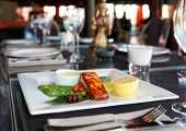 stock photo of salmon steak  - Asian style salmon steak on restaurant table - JPG