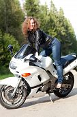 Woman Sitting On A Motorcycle