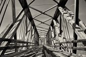 image of trestle bridge  - Monochrome abandoned and decaying trestle rail bridge - JPG