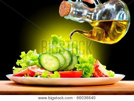Healthy Vegetable Salad with Olive oil dressing. Pouring Olive oil. Healthy vegetarian food. Vegan. Diet, dieting concept. Lettuce, tomatoes, cucumbers. Organic bio food. poster