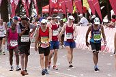 Runners Chatting And Joking During Comrades Marathon