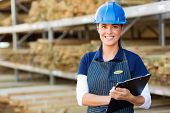 beautiful female industrial worker holding clipboard