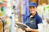 happy female clerk working in supermarket