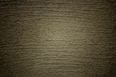 Khaki stucco wall background with vignette