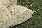 Vintage Wedding Dress Lying On Grass
