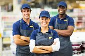 happy female hardware store worker and team