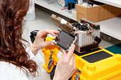 Woman Working With Fiber Optic Fusion Splicer