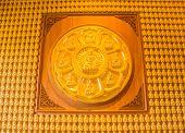 ten thousand golden buddhas lined up along the wall
