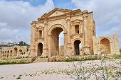 JERASH, JORDAN - MARCH 18, 2014: Hadrian's arch in the ancient city of Jerash. Since 2004, Jerash Ar