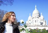 The beautiful woman with a rose before Basilica of Sacre-Coeur Montmartre. Paris.