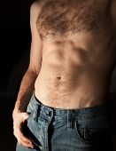 Flat Sporty Male Belly. Close-up Photo On Dark Background