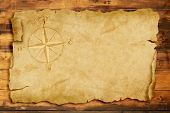 stock photo of wind-rose  - wind rose on old parchment with copy space - JPG