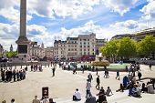 LONDON, UK - MAY 14, 2014: Trafalgar Square with lots of tourists. National gallery, Nelson monument