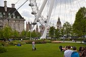 LONDON, UK - MAY 14, 2014: Jubilee park on south bank of the river Thames with London Eye view