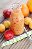 bottle of orange fruity smoothie - food and drink