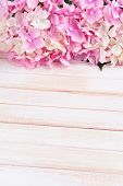 Bouquet of beautiful artificial flowers, on color wooden background