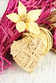 Decorative straw for hand made, flower and heart of straw, on wooden background
