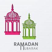 Colorful Intricate arabic lanterns on grey background for celebration of holy month Ramadan Mubarak.