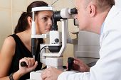 Male ophthalmologist conducting an eye examination