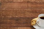 espresso coffee cup with a cookie on a rustic barn wood table - copy space