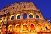 detail of the Flavian Amphitheatre or Coliseum in Rome, Italy, at night
