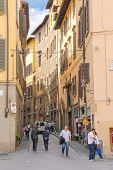People On The Street Of The Ancient Italian City Florence.