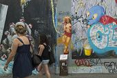 BERLIN, GERMANY - MAY 23, 2014: Fragment of graffiti on Berlin Wall at East Side Gallery - it's a 1.