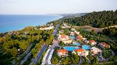 Aerial View Of Luxury Hotel With Pools, Buildings And Nature Surrounded By The Ocean, In Halkidiki,