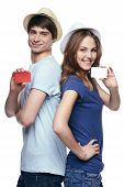 Happy couple showing credit cards