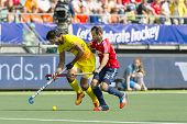 THE HAGUE, NETHERLANDS - JUNE 2: Englishman Catlin reaches for the ball, defending against by Indian