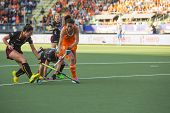 THE HAGUE, NETHERLANDS - JUNE 2: Dutch van As is passing the Belgium defense during the Hockey World