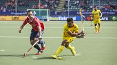 THE HAGUE, NETHERLANDS - JUNE 2 2014: Englishman Catlin reaches for the ball to stop a rush by India