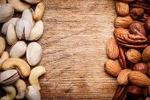picture of pecan nut  - Background texture of assorted mixed nuts including cashew nuts - JPG