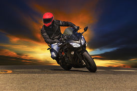 picture of recreational vehicle  - young man riding big bike motorcycle on asphalt roads against beautiful dusky sky use for sport leisure and male activities theme