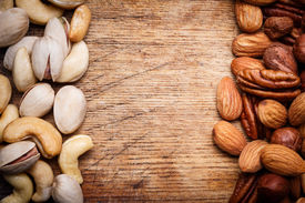 stock photo of mixed nut  - Background texture of assorted mixed nuts including cashew nuts - JPG