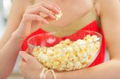 Closeup On Young Woman Eating Popcorn