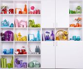 White shelves with colorful things in room