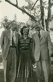 CANADA - CIRCA 1930s: Vintage photo shows portrait of a young woman and two men.